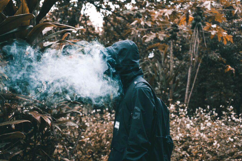 Man smoking in forest