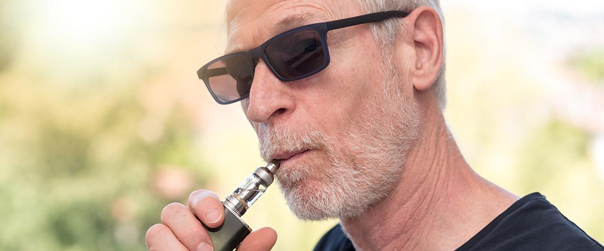 baby boomer man vaping